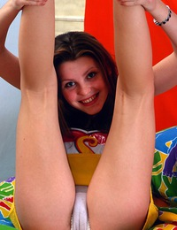 Blue eyed teen sweetie caresses her pussy in a soft bed