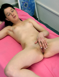 Teenage brunette caressing her cooch with soaked fingers