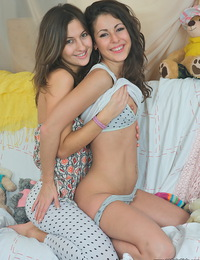 Two gorgeous brunette lezzies teasing each other on camera